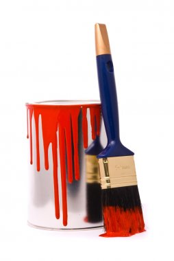 Can of red paint and professional brush