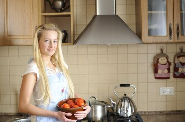 Young housewife in kitchen