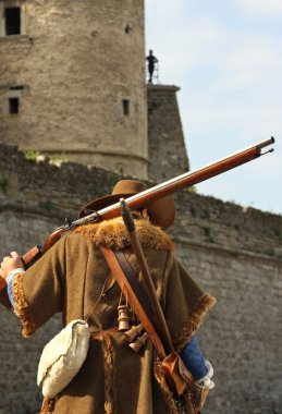 Musketeer against the backdrop of the castle