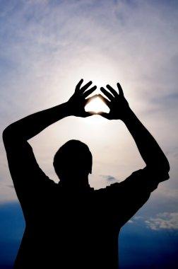 Sun in male hands