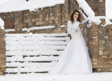 Bride in winter near the stair