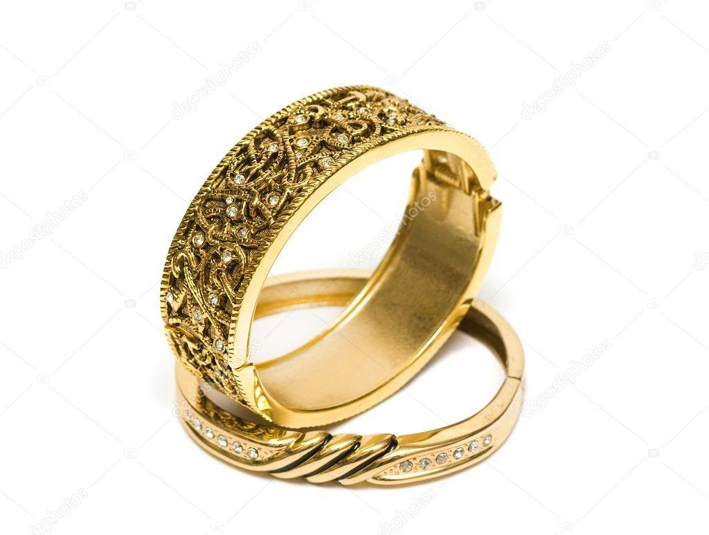 Golden bracelets isolated on white background