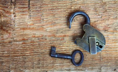 Old padlock and key on wood