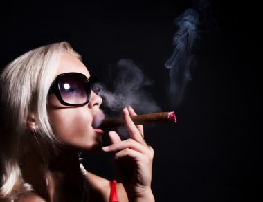 Blonde smoking a cigarette