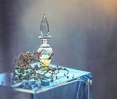 Fotografie Small bottle of perfume