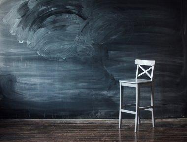 Wooden chair against a school desk