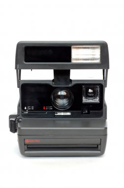 Camera over a white background.