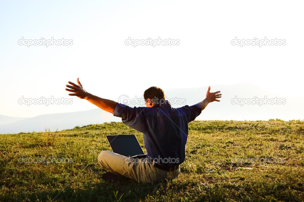 Freedom - Man using a laptop outdoors with copyspace