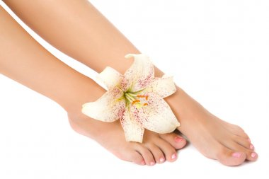 Woman foot with lily flower