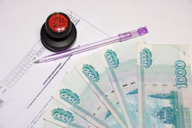 Russian money, tax return and pen