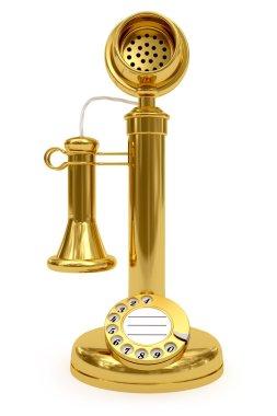 Golden retro-styled telephone on white
