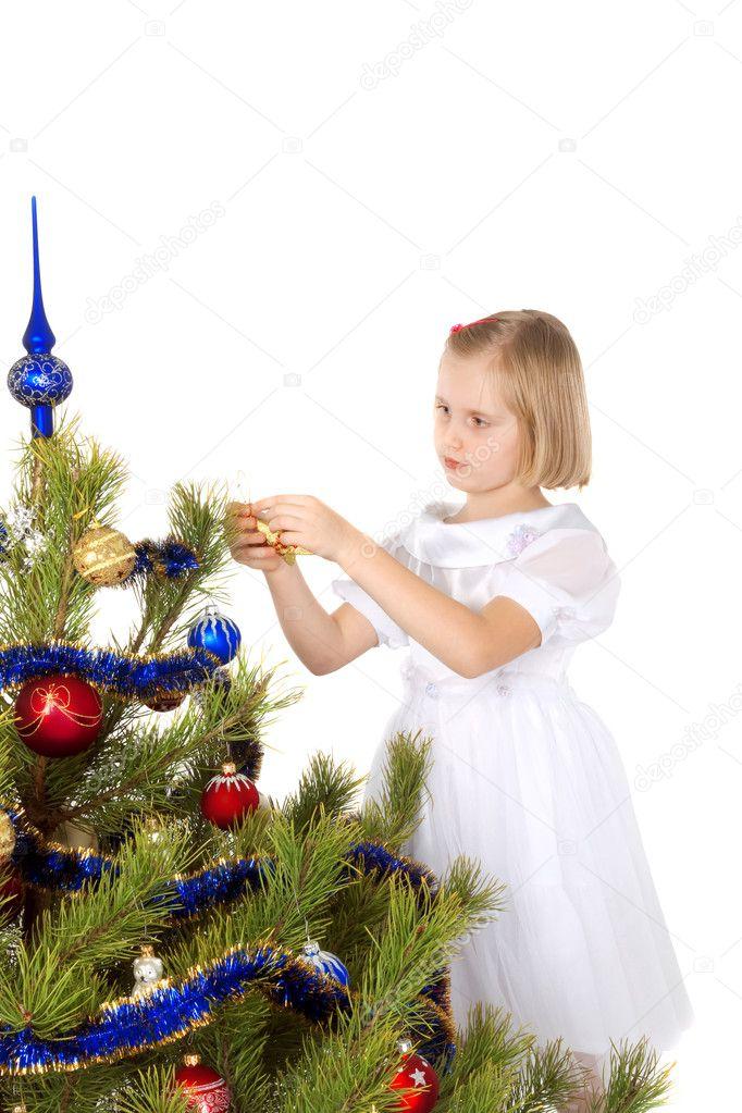 Nice girl decorates a Christmas tree