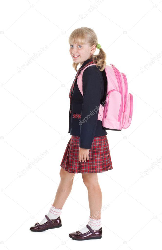 Happy schoolgirl goes to school