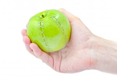 Green apple in a masculine hand