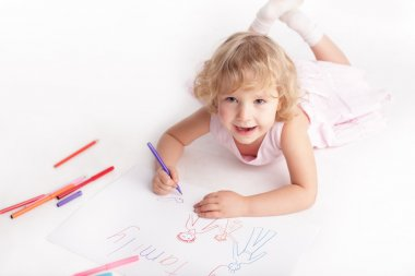 Little girl drawing the family stock vector