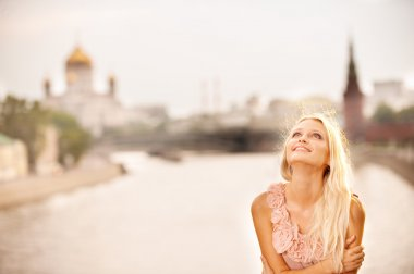 Girl against Moscow Kremlin and river