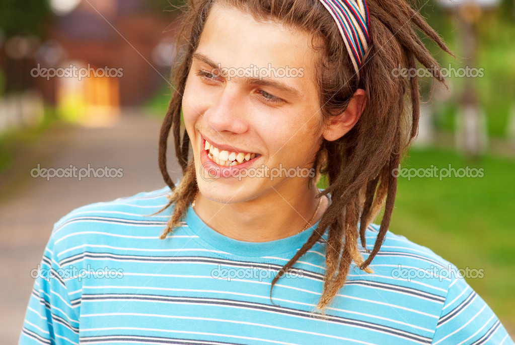 Young man with dreadlocks