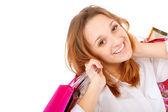 Fotografie Porträt einer jungen Frau mit mehreren Einkaufstüten