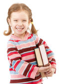 Pěkné předškolní dítě drží učebnice