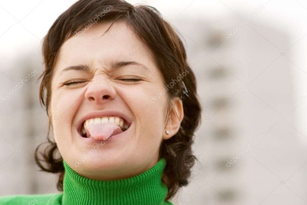 Black hair girl showing tongue