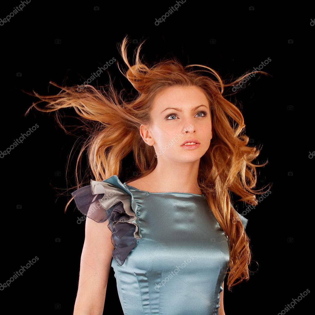 Healthy beautiful long hair in motion created by wind