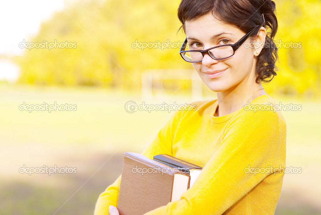 Young student holding books