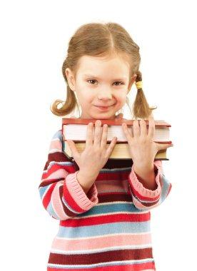 Nice preschool child holds textbooks