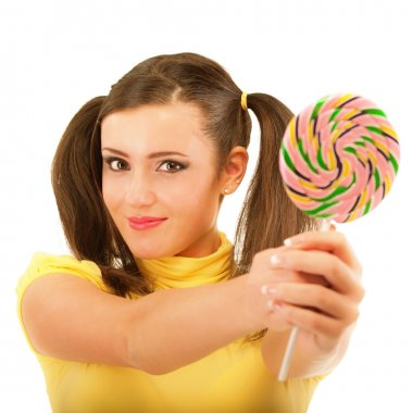 Girl with plaits holds lolipop
