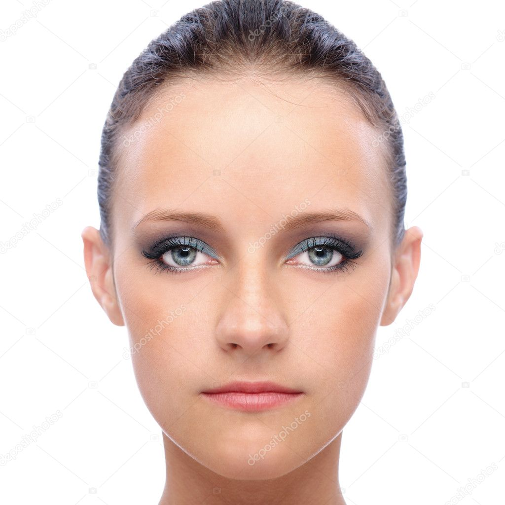 Face of young woman, on white background.