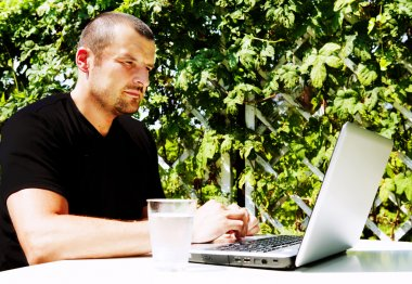 Man working with laptop outside