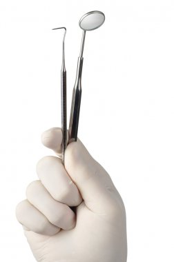 Hand with Dental tools
