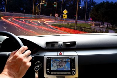 Night riding in street traffic with gps map