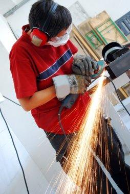 Metal worker with grinder