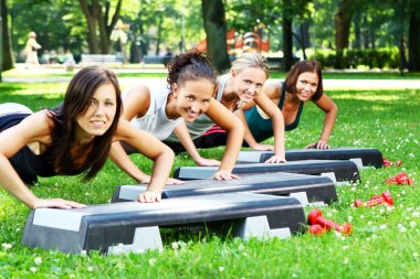 Young and attractive girls doing fitness exercises