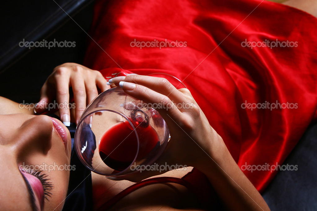 Young and sexy woman with wine