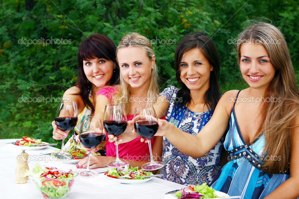 Group of young womens drinking wine
