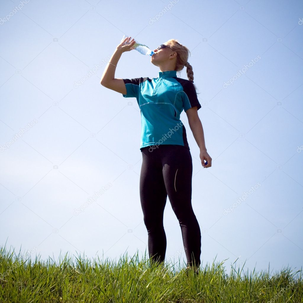 Drinking water after running outdoors