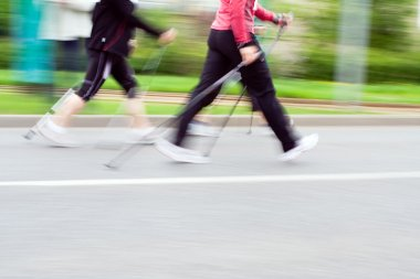 Women on nordic walking race, blurred