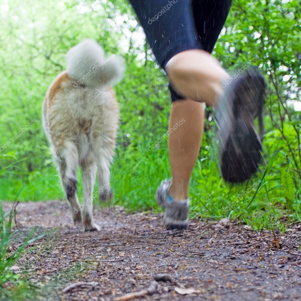 Woman running in forest, motion blur