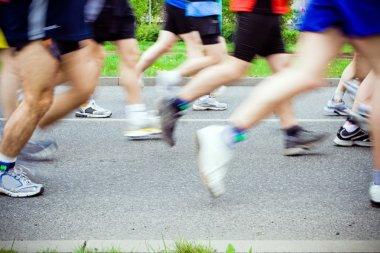 running in marathon on city streets
