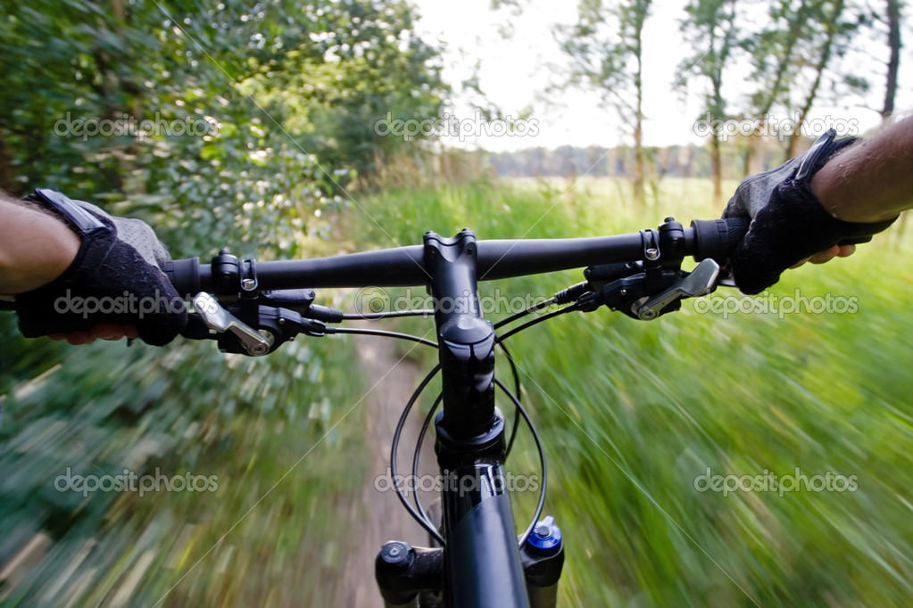 Riding mountain bike in summer