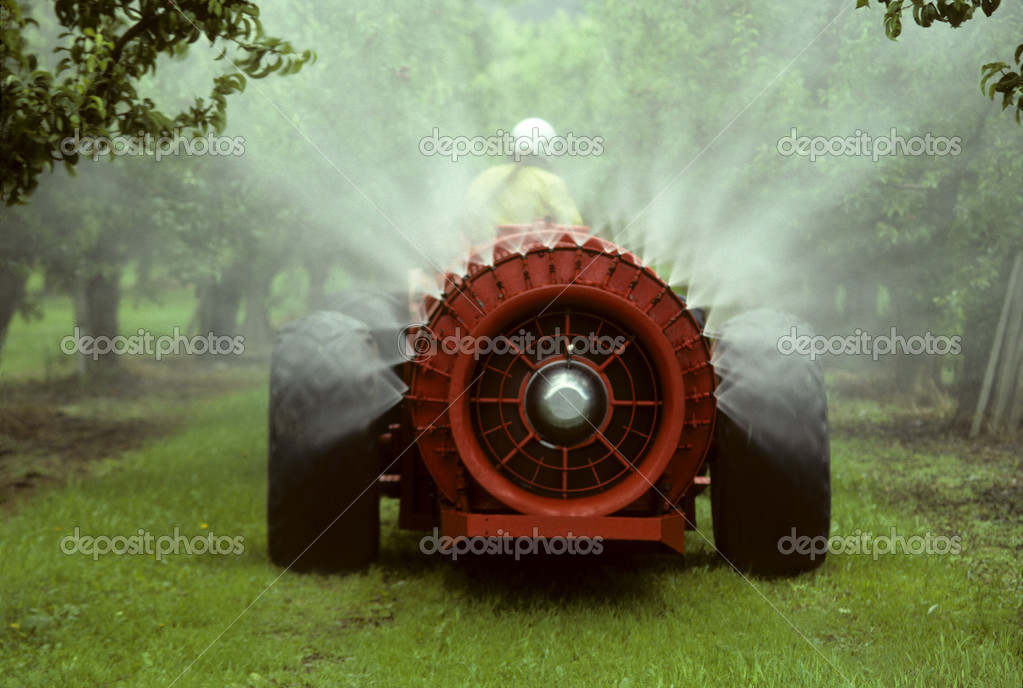 Sprayer in an apple orchard