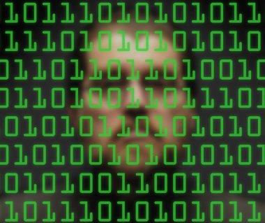 Man monitoring green binary code