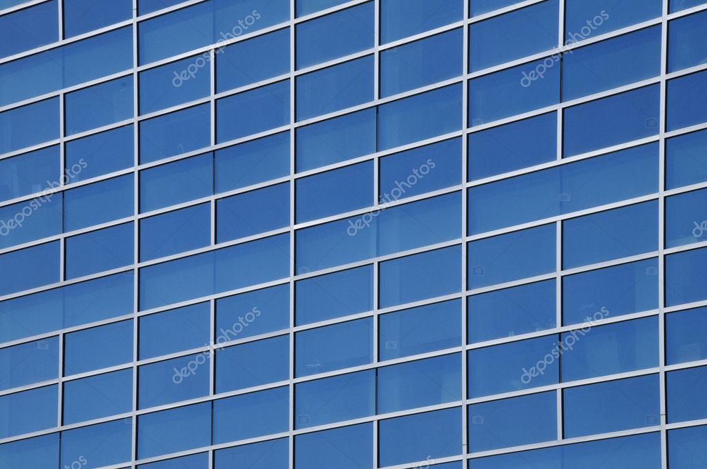 Ventanas exteriores de un edificio de oficinas comerciales for Oficinas comerciales en el exterior