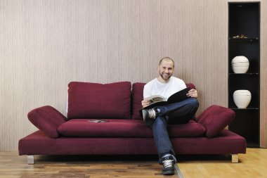 Young man relaxing in modern living room