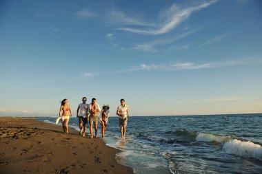 group running on the beach