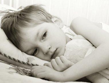 Sad child in bed