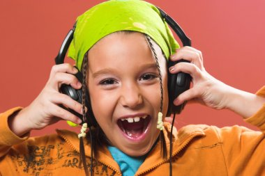 Child listening music in headphones