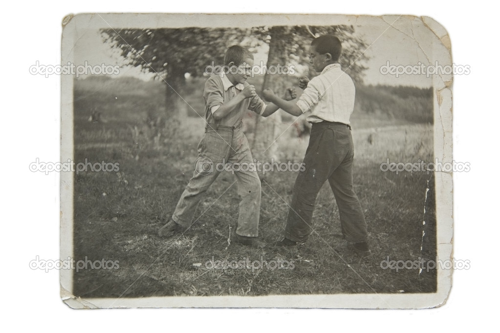 Two boys are fighting, an old photo