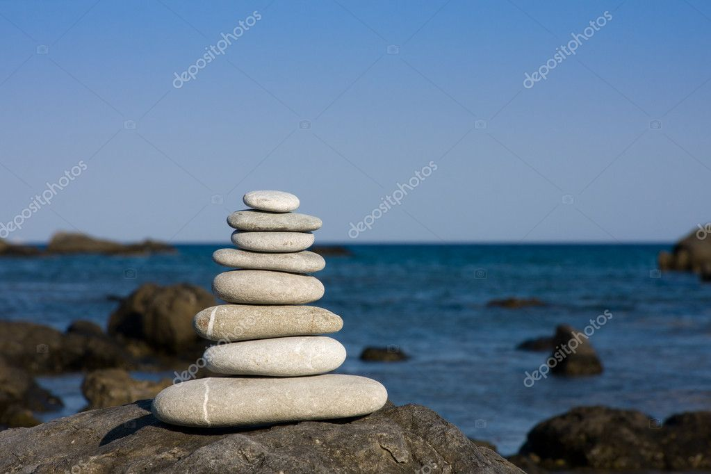 Eight white pebbles on beach